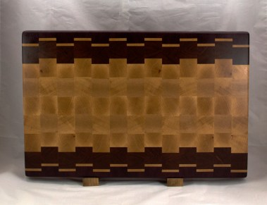 "Cutting Board 16 - End 050. Purpleheart, Hard Maple & Jatoba. End Grain. 15"" x 21"" x 1-1/2"". Sold at its first showing."