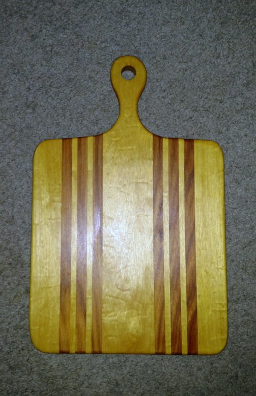 """Small Sous Chef 16 - 024. Quilted Yellowheart & Canarywood. 9"""" x 16"""" x 3/4""""."""