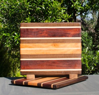 "Cheese Board 17 - 322. Black Walnut, Hard Maple, Bubinga & Honey Locust. 9"" x 11"" x 7/8""."