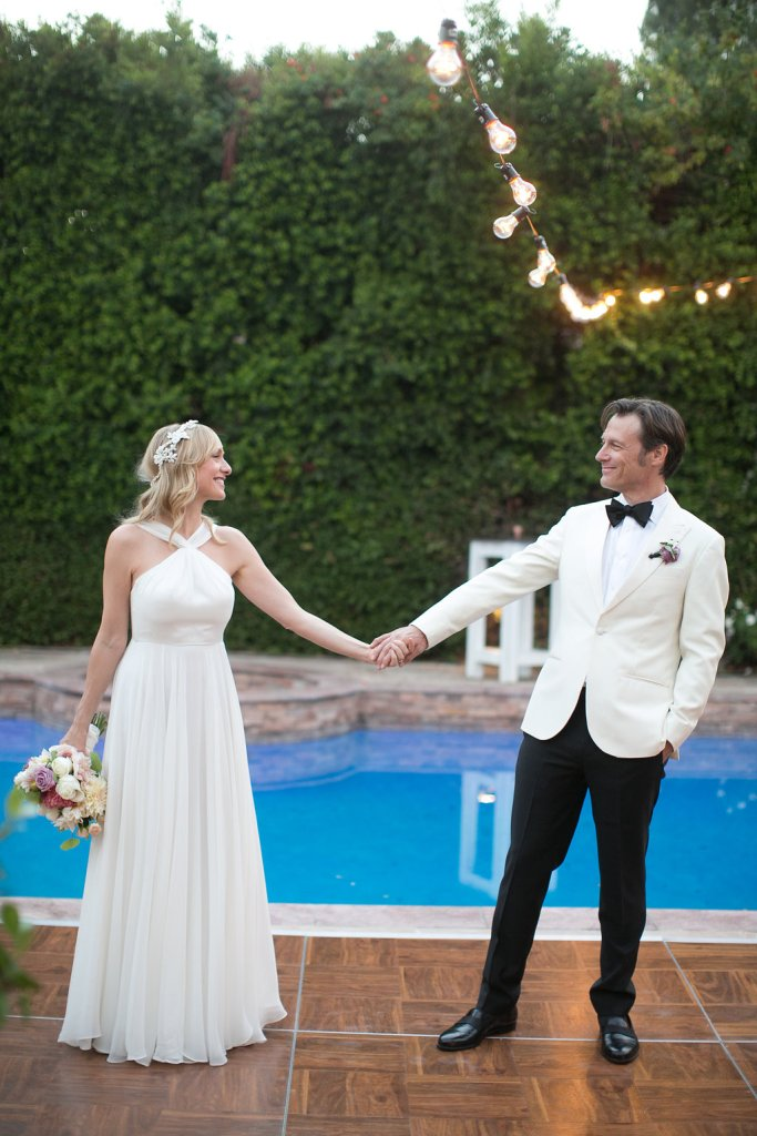 bride & groom poolside