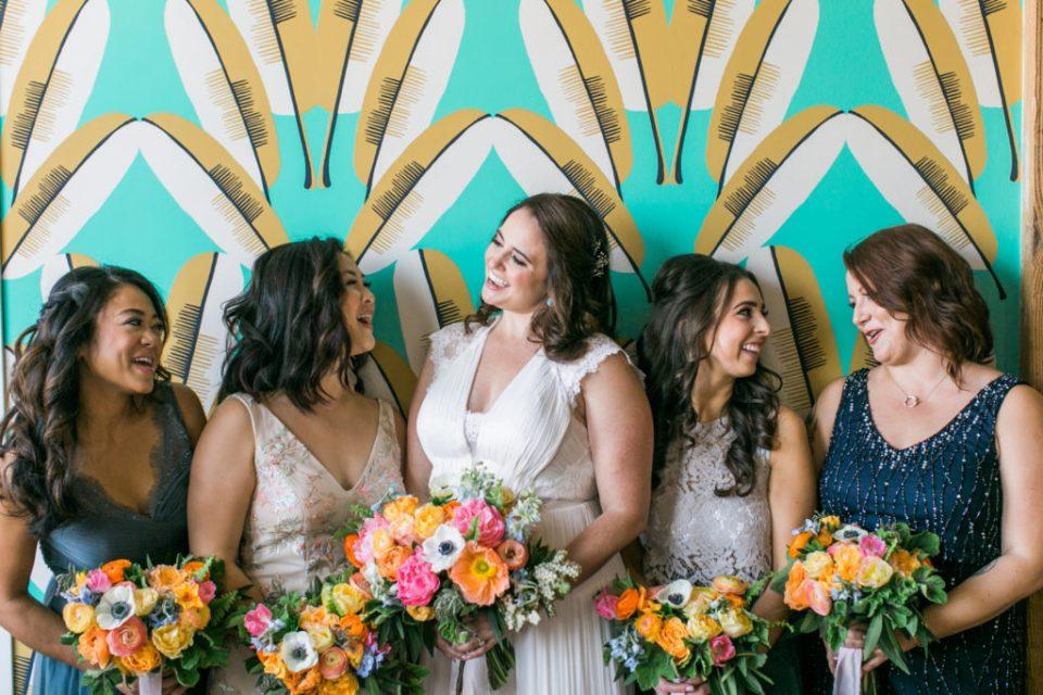 Bride & Bridesmaids with vibrant bouquets