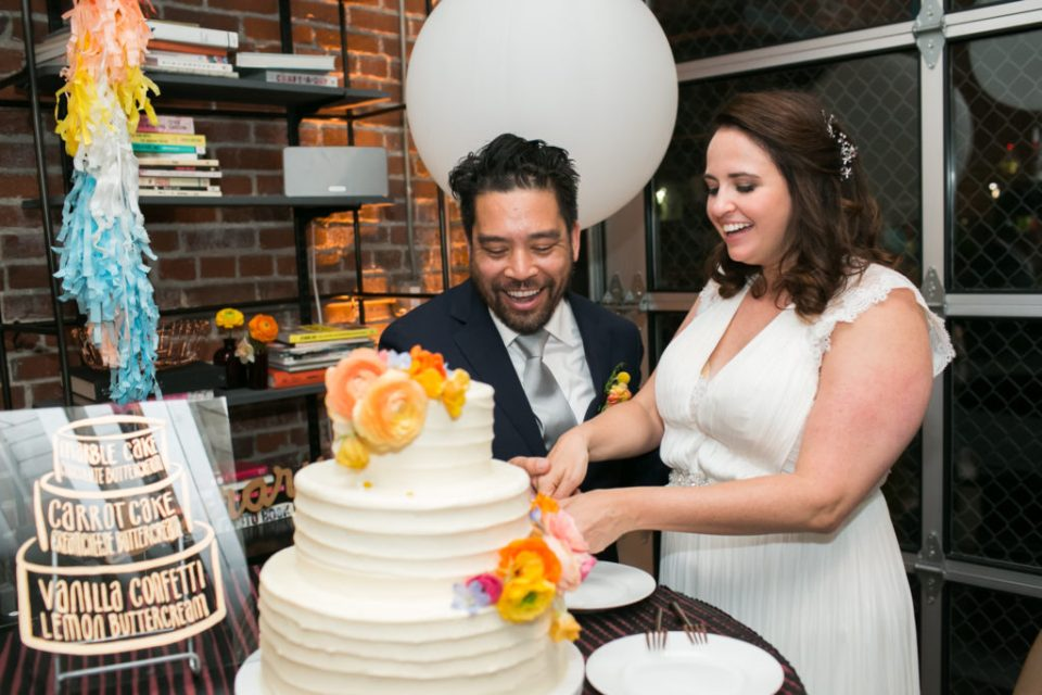 Bride & Groom cut white three tiered cake