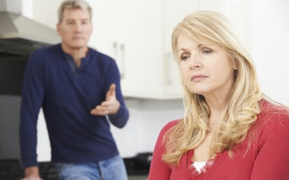 A middle aged woman appears upset as she looks away from her husband gesturing with his hand. They are experiencing relationship difficulties due to Coivd. Moxie Family Therapy offers online relationship counseling in Orange County, CA. We offer couples counseling, marriage counseling, and more. Contact us today to get in contact with marriage counselors.
