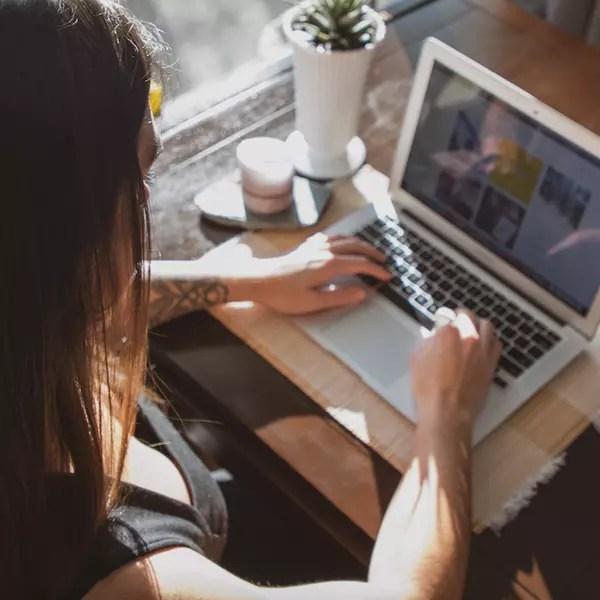 Digital Marketing Strategist Maggie Spizzirri reviewing a social media strategy