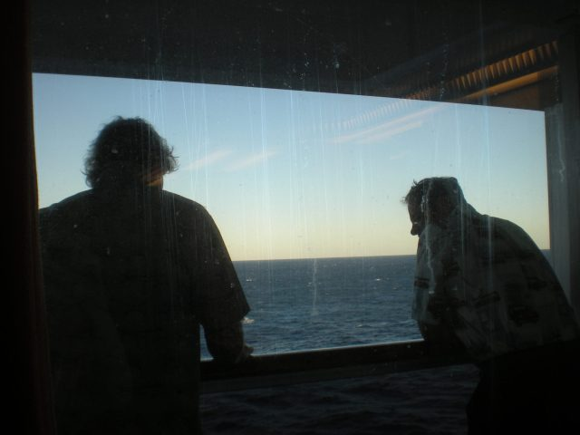 staring out at sea on the balcony of the Carnival cruiseship