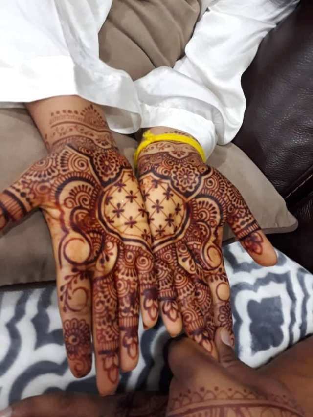 henna applied to hands during mehendi