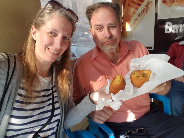 Sampling Arancini on our one day in Palermo