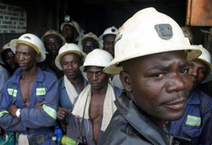 Zambian copper miners wait in a lift before going to work underground in Konkola, Zambia.