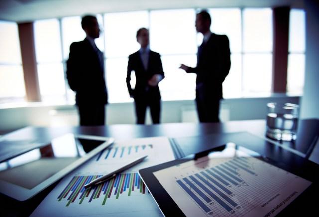 Close-shot of a tablet computer displaying financial data, three