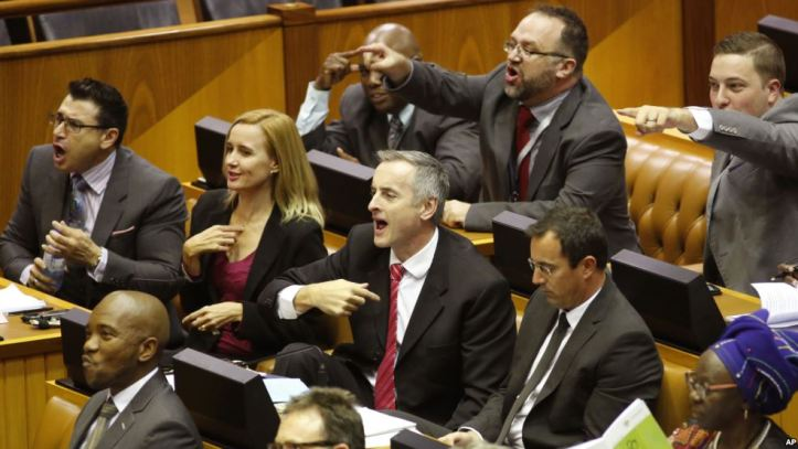 south-african-lawmakers-are-seen-reacting-during-a-parliamentary-session-in-cape-town