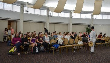 Students, staff and community members watch the members of Sigma Delta Pi as they demonstrate traditional hispanic dances at the International Week Language and Folklore event on April 10 in the Bovee UC.