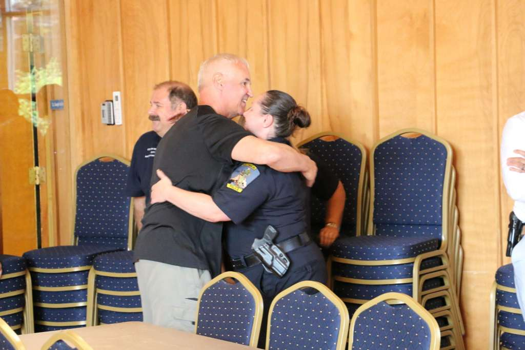 Lt. Korn hugging Officer Scanlon