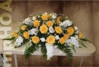 # MPCASK002 — $250.00 — Yellow Roses, White Stocks, White Snapdragons, White Montie Casino, White Mini Carnations. ~ Approximate size: 16″H x 38″W. ~