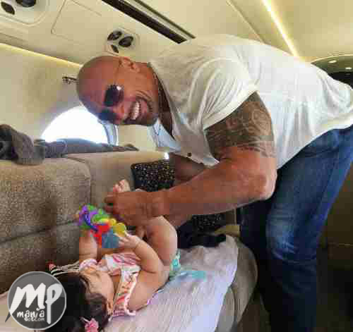 """wp-1469808272959-1 Cute Photo of Dwayne """"The Rock"""" changing his daughter's diaper"""