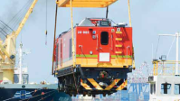 The first locomotive imported by Transnet Freight Rail from China is offloaded at FPT Durban