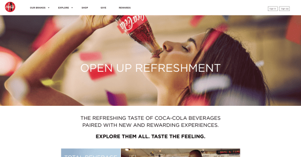 Coca-Cola's website features a large hero image across the top half of the screen.
