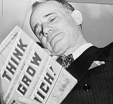 napoleon_hill_holding_book_1937