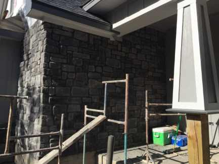 Rock Siding Going up around front porch