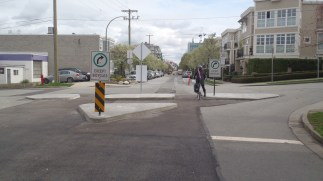 Turn restrictions at intersections prevent through traffic, eliminating rat-running.