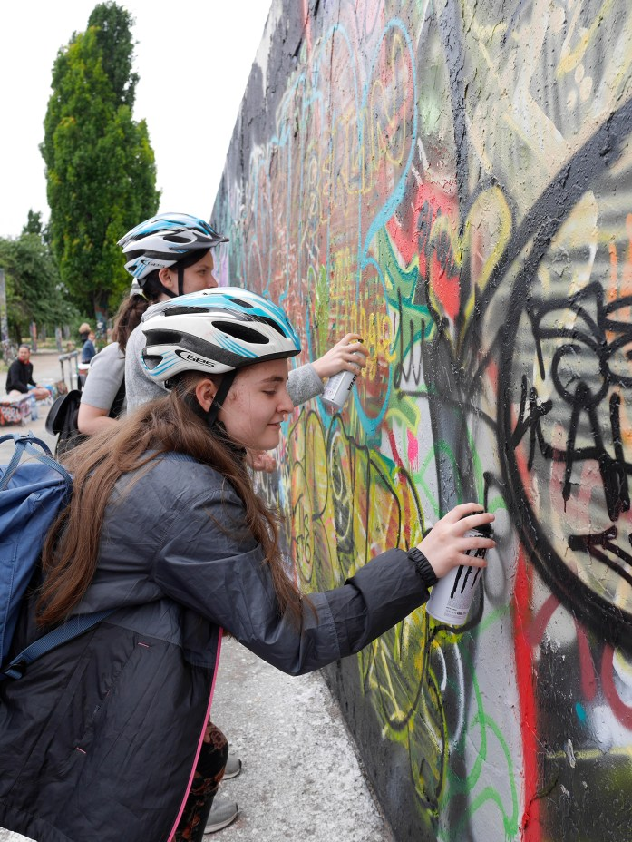 Bella Jackson spray-paints the Berlin Wall