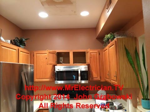 microwave oven over stove with