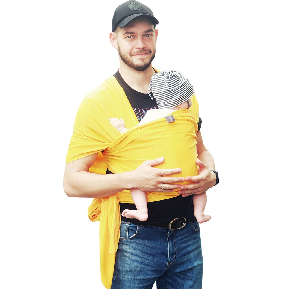 Dad demonstrating baby carrier sling and infant wrap