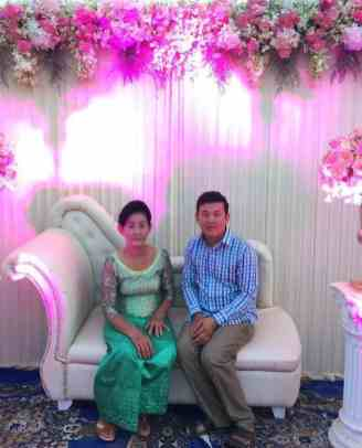 Ly Barang with his mum at a wedding ceremony in Cambodia