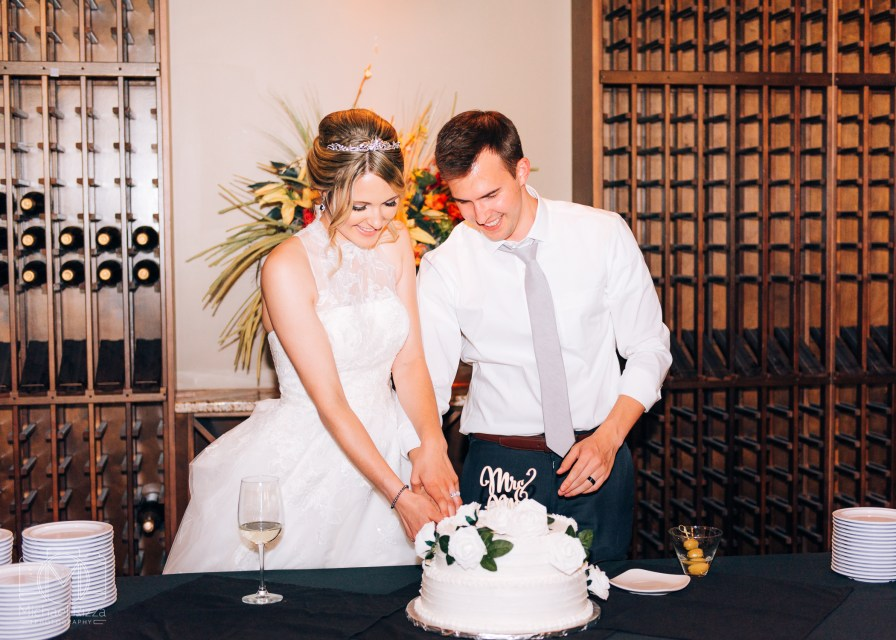 Cake cutting - Atlanta Catholic Church wedding photography - Michael Rizza Photography