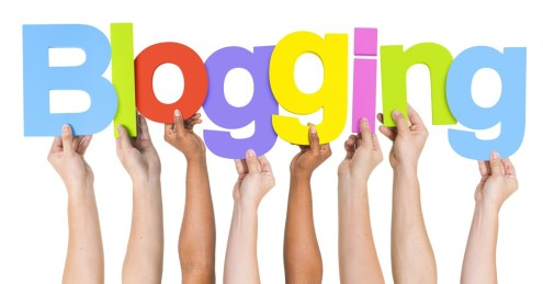 Multi Ethnic People Holding The Word Blogging