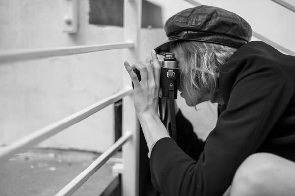 leica cl review - girl in hat with old camera B&W - zenit film