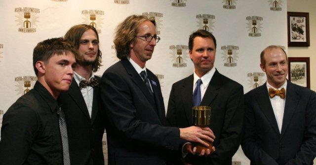 Kit Boss, center, holding an award for Best TV Production