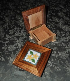 Inset tile curio boxes. The lids are Koa and ceramic; the rest of the box is Hard Maple.