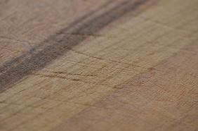 The wood fibers have been scored. The chopping and cutting has damaged the board … can it be restored?