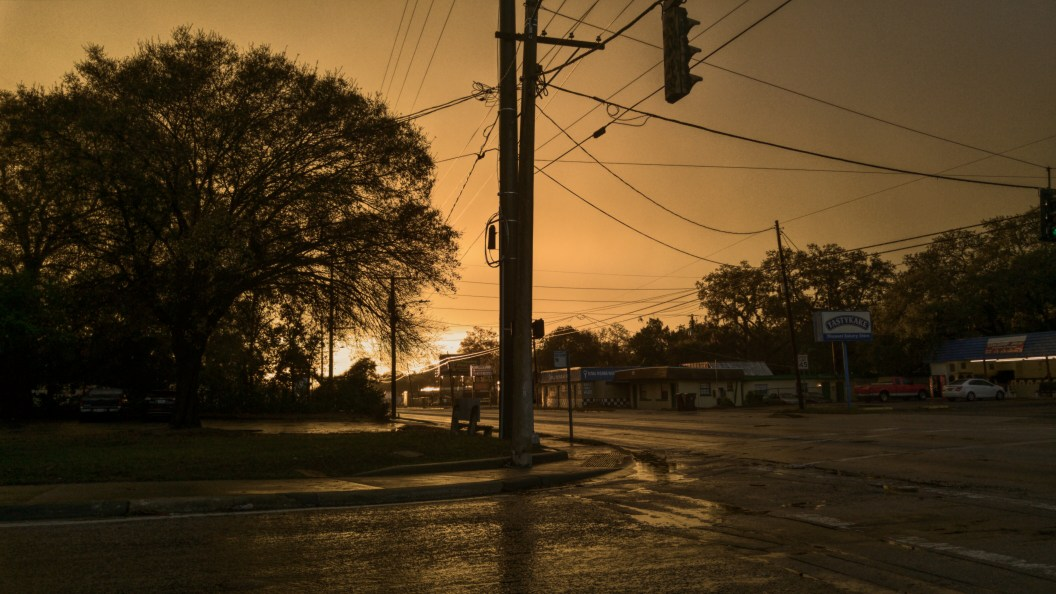 Sunset at an urban intersection.