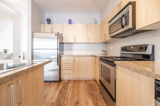"""Photo 1: 67 6575 192 Street in Surrey: Clayton Townhouse for sale in """"IXIA"""" (Cloverdale)  : MLS®# R2495504"""