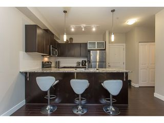 """Photo 3: 211 9655 KING GEORGE Boulevard in Surrey: Whalley Condo for sale in """"GRUV"""" (North Surrey)  : MLS®# R2139260"""