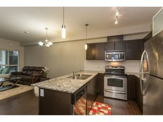 """Photo 5: 211 9655 KING GEORGE Boulevard in Surrey: Whalley Condo for sale in """"GRUV"""" (North Surrey)  : MLS®# R2139260"""