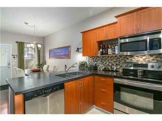 Photo 3: 203 3000 RIVERBEND Drive in Coquitlam: Coquitlam East House for sale : MLS®# V1138004