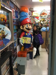 My wife posing with Mario