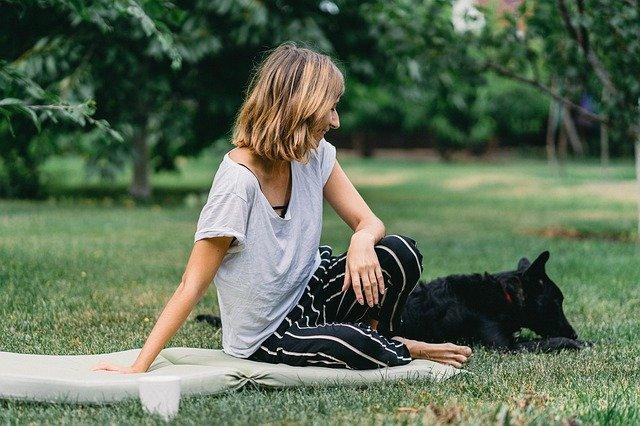 Woman having picnic with dog