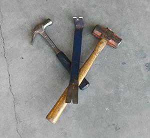 Hammer, prybar, and a sledge