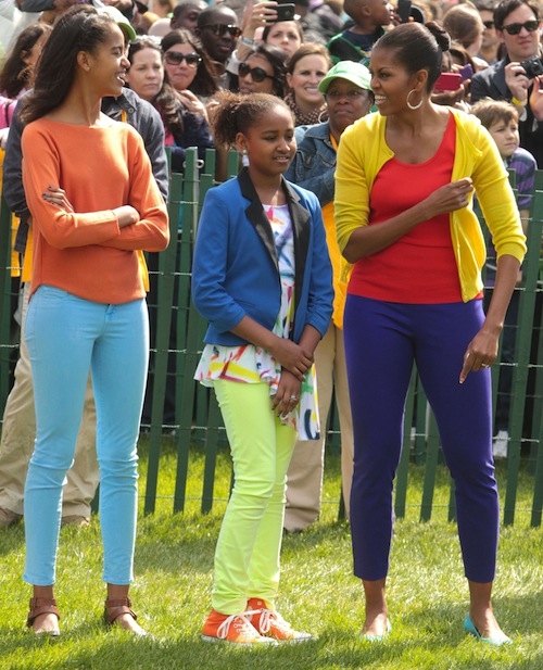 Michelle Obama wears yellow, orange, and purple colorblocked outfit