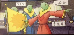 Three green aliens in their spaceship holding a yellow flag and talking in an alien language