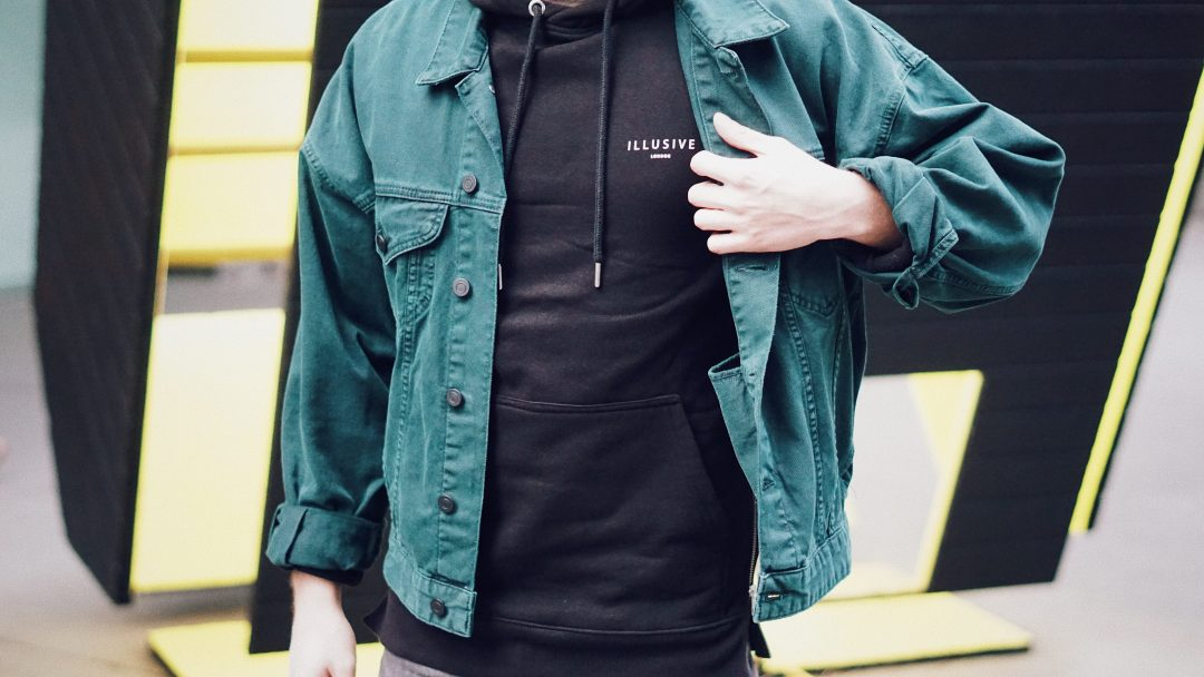 Wearing Oversized Denim Jacket in Bottle Green from ASOS, Hoddie from Illusive London and Jeans from ALLSAINTS.