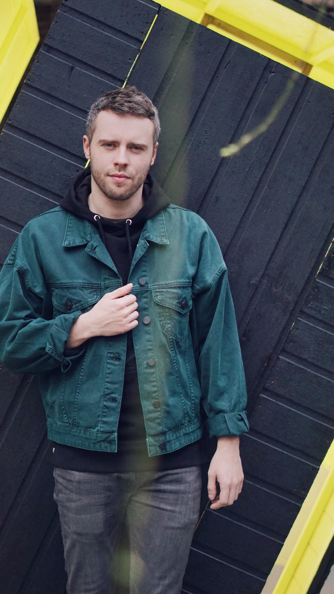 "Wearing Oversized Denim Jacket in Bottle Green from ASOS, Hoddie from Illusive London and Jeans from ALLSAINTS. ""Black Shed Expanded"" by Nathaniel Rackowe, shot outside Parasol unit foundation for contemporary art."