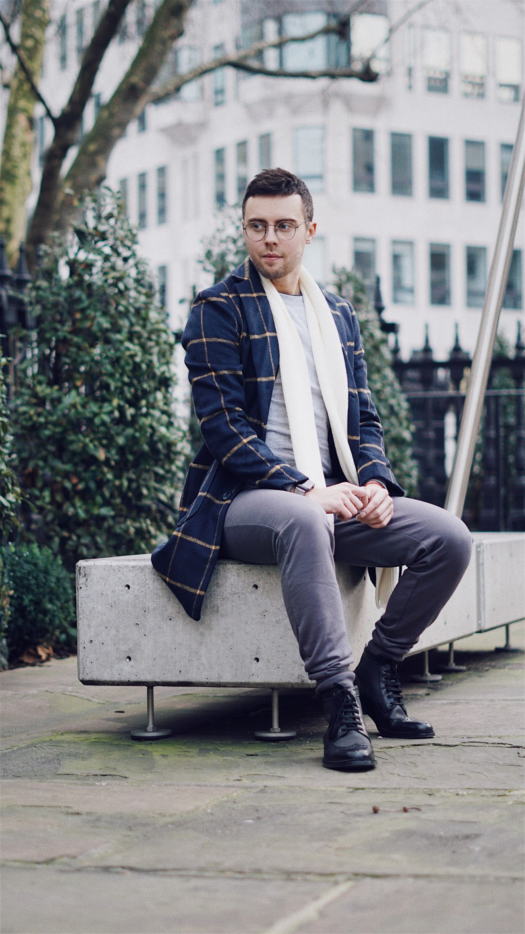 The Idle Man. Wearing Check Overcoat in Navy, Classic Long Sleeve T-Shirt in Grey, Slim Fit Joggers in Grey and Knitted Scarf Off White. Also, Goodwin Smith Bashall Boots in Black and Apple Watch Strap in Monochrome from Case Station. Shot by Oliver Burton @ByOllieB. Blog by Skirmantas Petraitis.