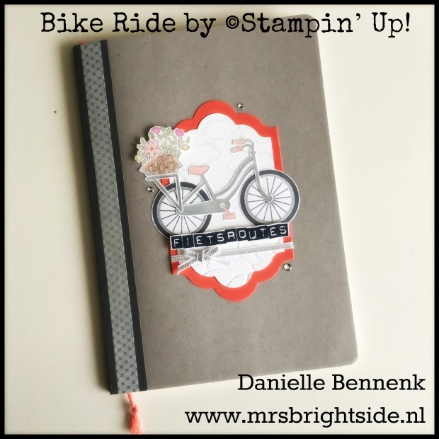 Pimped notitieboek, 'kasseien' gemaakt met de Petalburst embossing folder. Bloemenmand ingekleurd met watercolor pencils. / Pimped notebook. Cobble road made with Petalburst embossing folder. Flower basked colored with watercolor pencils.