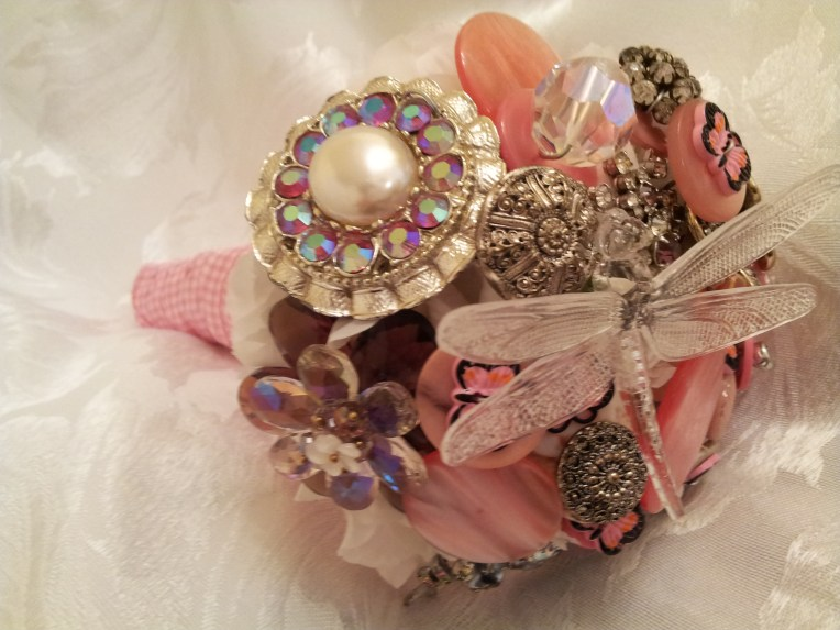 A mix of buttons and brooches