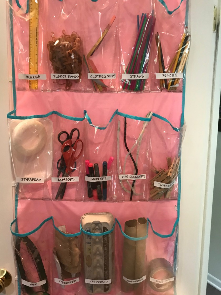 shoe organizer with household items and labels