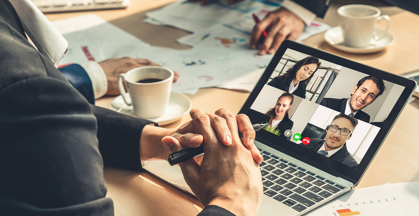 multiple people participating in group video business conference call